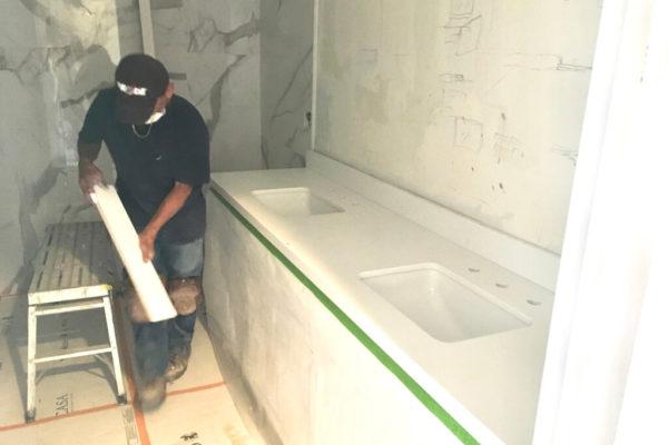 13b Amron worker installing backsplash