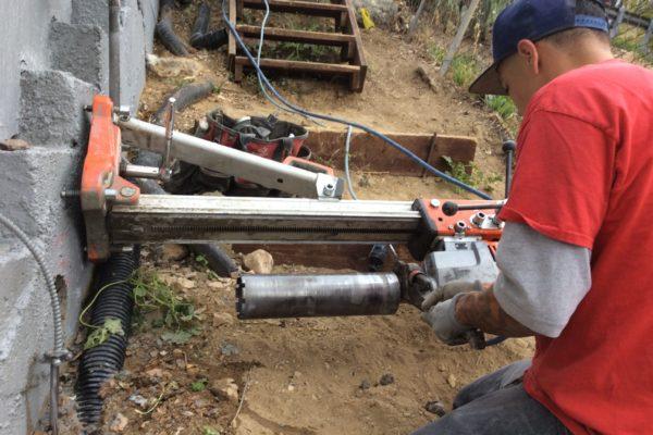 Installing drain pipe 2 © amronconstruction.com