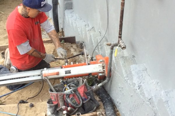 installing drain pipe 4 © amronconstruction.com